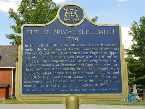 Historic plaque about the de Puisaye Settlement located in front of St. John's Anglican Church Jefferson.  The de Puisaye Settlement 1799  In the fall of 1798 some 40 exiled French Royalists under the leadership of Joseph-Genevieve, Comte de Puisaye (1754-1827), emigrated from England to Upper Canada. The following year they were given rations and agricultural implements and settled along Yonge Street in the townships of Markham and Vaughan. However, these members of the nobility and their servants were unable to adapt themselves to a pioneer existence and by 1806 their settlement, known as Windham, was abandoned. De Puisaye lived for a time on an estate near Niagara, but returned to England in 1802. Erected by the Ontario Archaeological and Historic Sites Board.