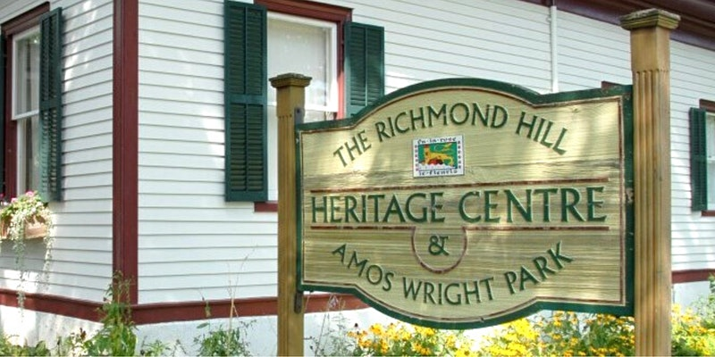 Photograph of the Richmond Hill Heritage Centre and Amos Wright Park sign.